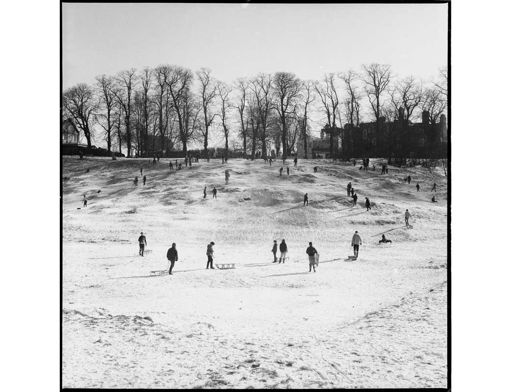Sledging on Hampstead Heath. In late February 1969, snowdrifts lay across southern England. The slopes of Hampstead Heath are traditionally popular for sledging, especially Parliament Hill which gives views across London.