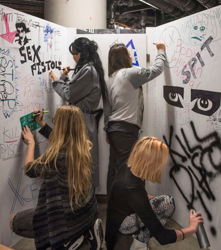 Students from Central Saint Martins decorate punk display.