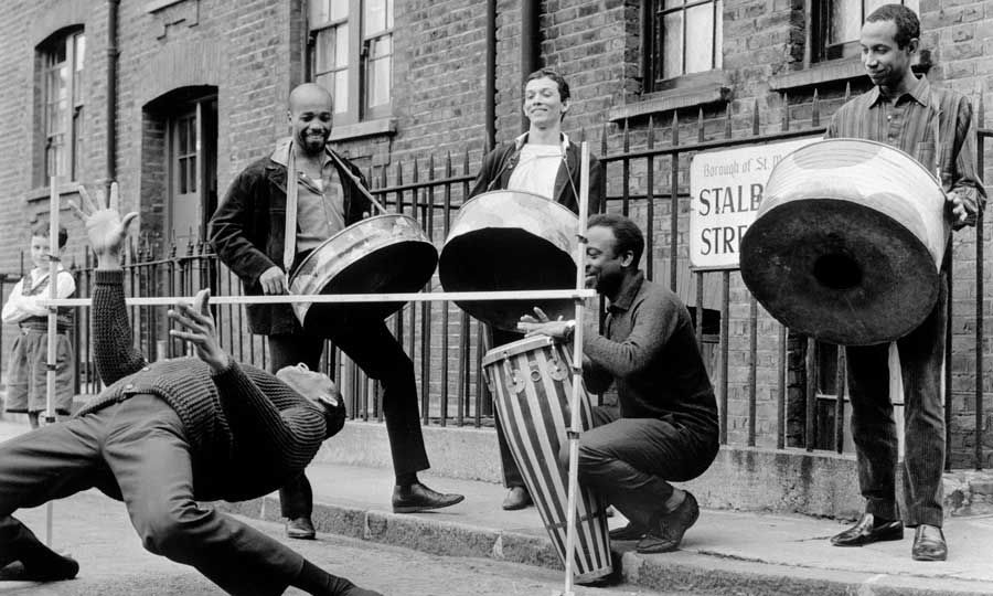 The Irwin Clement Steel Band play on a London street in 1964 © Henry Grant Collection.