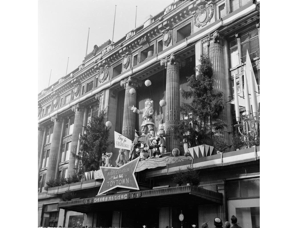 The exterior Christmas display at Selfridges in December 1953. Extravagant and elaborate window and exterior displays at Christmas time and during Royal celebrations have been a tradition at Selfridges since the founder Henry Selfridge first lit the shop windows at night for passers by to see goods on sale in 1890.