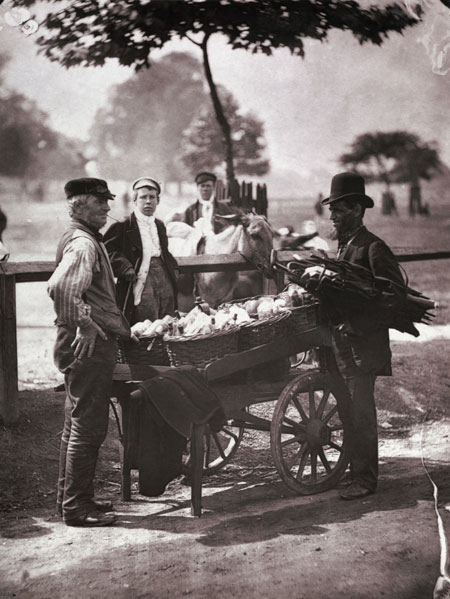 A 'Mush-Faker' was a street trader who made, mended and sold umbrellas. In this photograph he is talking to a man vending his home-made ginger beer. The image is taken from a series of 37 photographs published in the book, 'Street Life in London' (1877), with text written by John Thomson and the journalist Adolphe Smith. After taking photographs in the Far East, Thomson opened a portrait studio in London in 1875. Two years later he collaborated with the journalist, Adolphe Smith, to produce 'Street Life in London'. The book was conceived as a follow-up to Henry Mayhew's famous study, 'London Labour and the London Poor' (1861–2). The photographs were used to guarantee the book's authenticity.