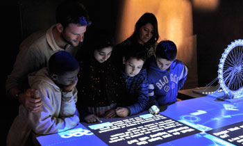 People looking at a digital display