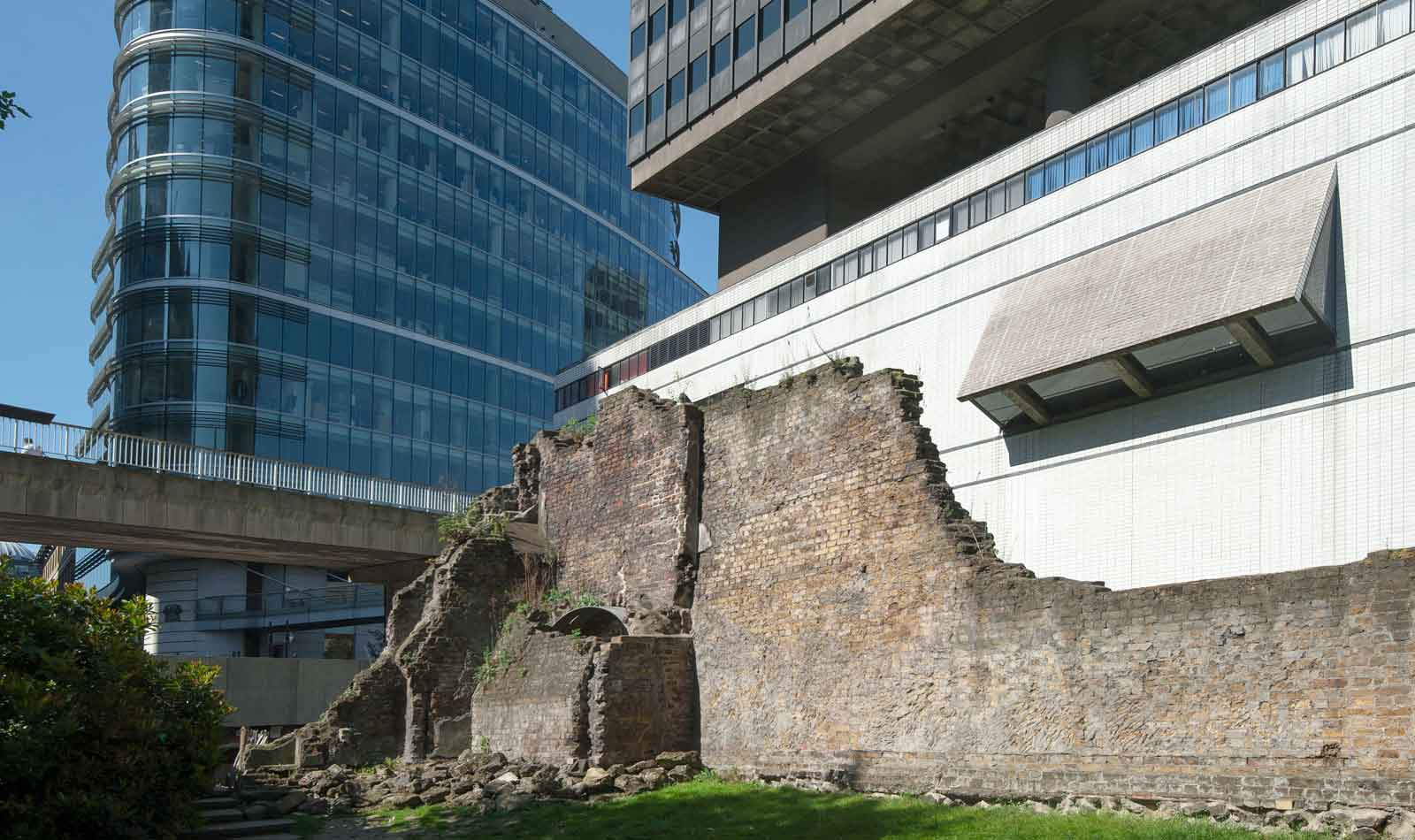 Looking from the gallery over the remains of London's wall you are looking at a mix of Roman, medieval and Victorian building. Here you are outside of Roman London, looking in to what was once the fort and later part of the city wall. 2000 years ago who might have been looking back?