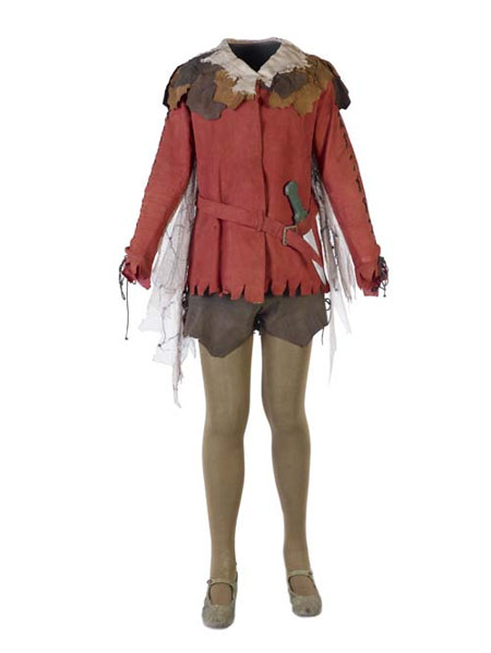 The actor Pauline Chase wore this costume when she played the role of Peter Pan at the Duke of Yorks theatre in London's West End in 1911. The outfit consists of a rust coloured suede jacket and belt with gold-coloured buckle, and net wings attached to sleeves.