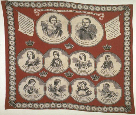 Cotton handkerchief dyed turkey red; lithographic print in dark brown ink, 1853-1857. This handkerchief was produced before the birth of Queen Victoria's last child, Princess Beatrice, born in 1857. Like many handkerchiefs of the period, it has been printed hastily, causing the image to run untrue to the grain, so that it cannot now be straightened.
