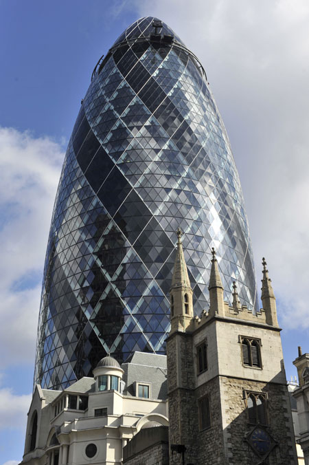 30 St Mary Axe, also known as the Gherkin and the Swiss Re Building. It is a skyscraper in London's main financial district, the City of London, completed in December 2003 and opened on 28 April 2004. It is 180 metres (591 ft) tall, with 40 floors. The building was designed by Lord Foster, his then business partner Ken Shuttleworth. Its construction symbolised the start of a new high-rise construction boom in London.