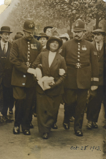 The arrest of a suffragette who had attempted to reach the royal coach during the Royal Wedding Procession, October 1913.