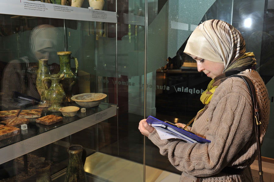 A postgraduate student studies at the Museum of London.