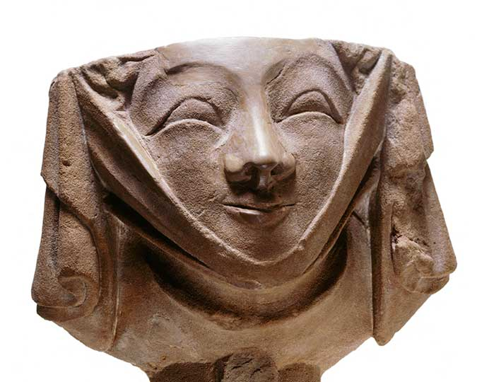 Carved head representing a fashionably dressed young woman with a 'wimple' or neck cloth under her chin, associated image