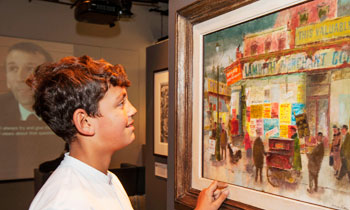 A child looks at a modern artwork during visit to the Galleries of Modern London.