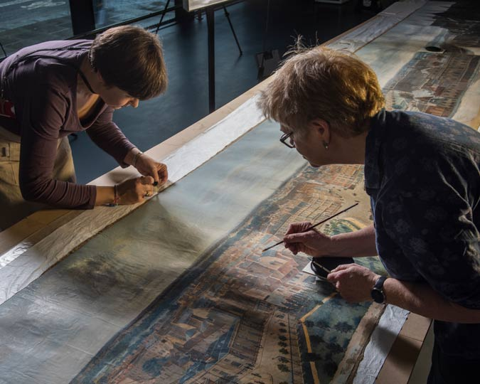 Museum of London conservators work to restore the Prevost panorama.