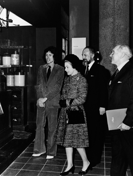 H.M. The Queen on Thursday 2nd December 1976 opening the Museum of London. Also Present Mr Colin Sorensen, keeper of the Modern Department and Mr Tom Hume, Director of the Museum of London.