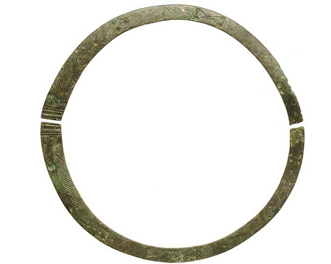 A bronze neck ring or torc found in the Harper Road burial associated image