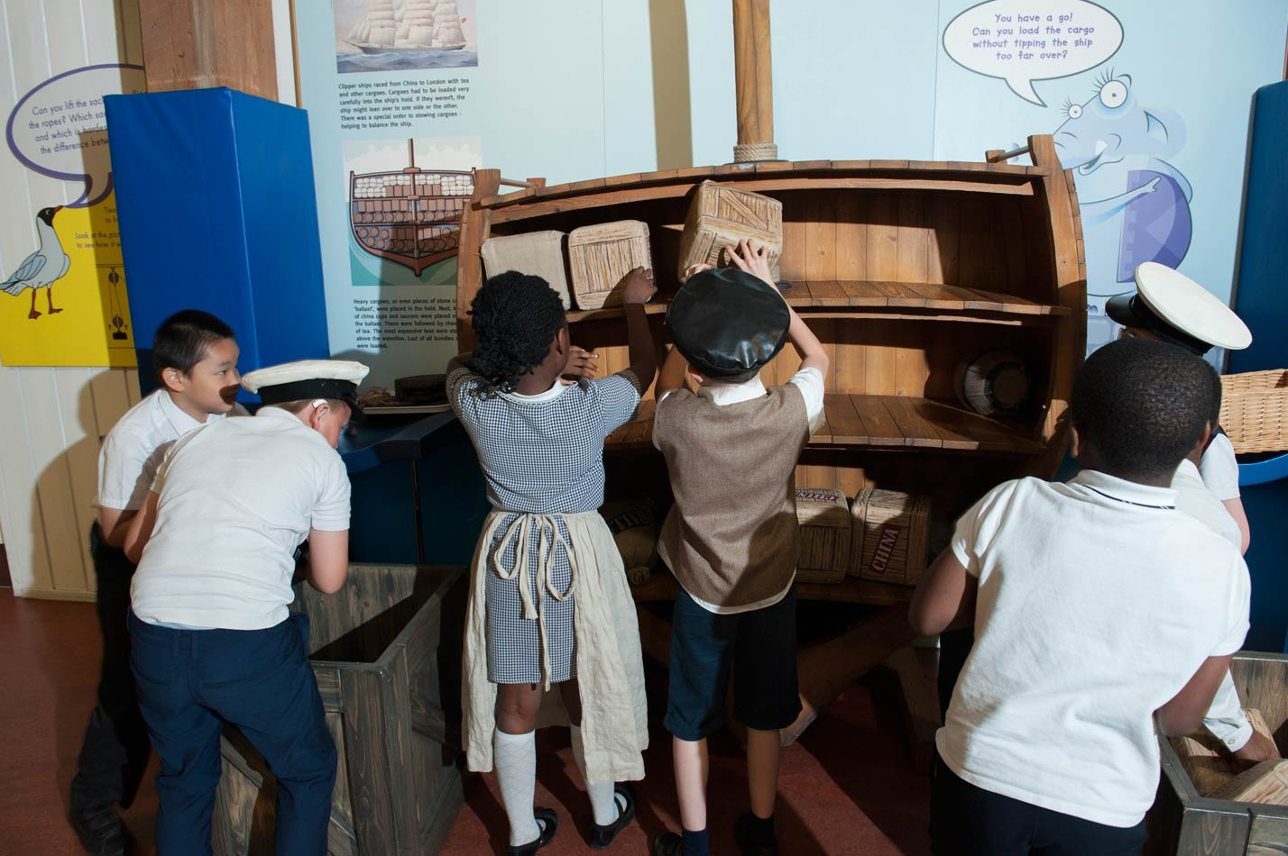 Children visiting the Mudlarks gallery play with the Tip the Clipper interactive.