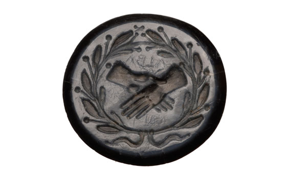 Roman intaglio with clasped hands, no. 001508 on Picturechase.