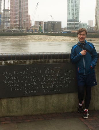 Secret Rivers curator, Tom Ardill, stands by a place marking the course of the River Tyburn into the River Thames.