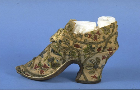 These women's shoes from around 1720-50 have been made from re-used materials.  The embroidered sections have come from fabric dating to the 1620s (possibly old shoes) and the various elements have been tailored to reflect contemporary fashions.  Off-cuts of white kid form the ill-fitting and slightly miss-matched linings.
