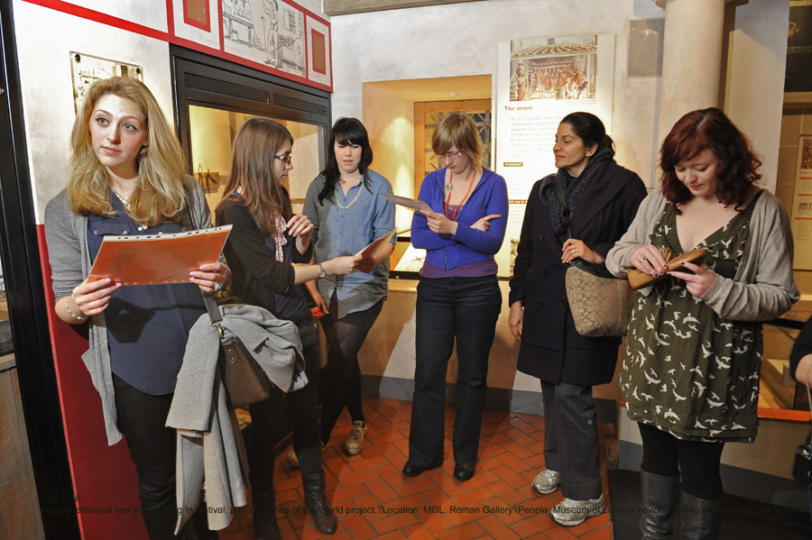 A group of higher education students visits the Museum of London's Roman gallery.