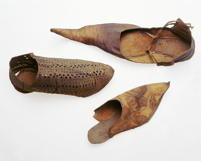 Selection of medieval leather shoes, including one with a very strong point.