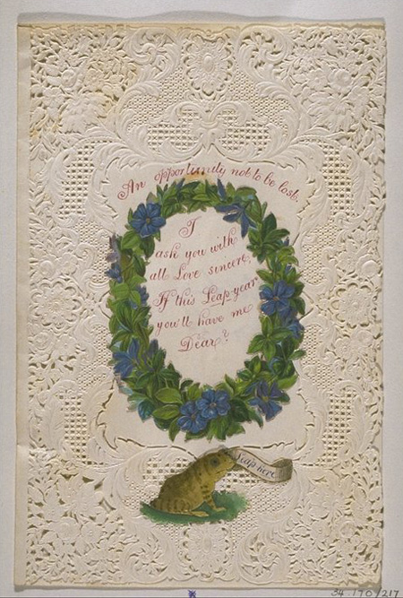 Valentine's card of white lace paper with embossed flower decoration and central white panel on which is handwritten 'An opportunity not to be lost. I ask you with all love sincere If this leap Year you'll have me dear'.