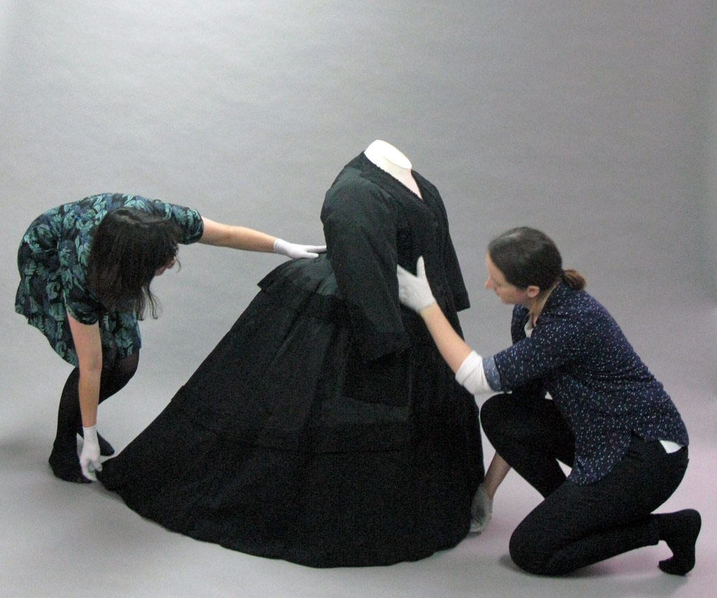 Museum of London conservators put Queen Victoria's mourning dress on a mount.