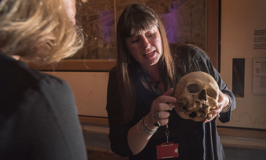 Curator Jelena Bekvalac demonstrating how the museum's skeletal collections help us understand London's past.