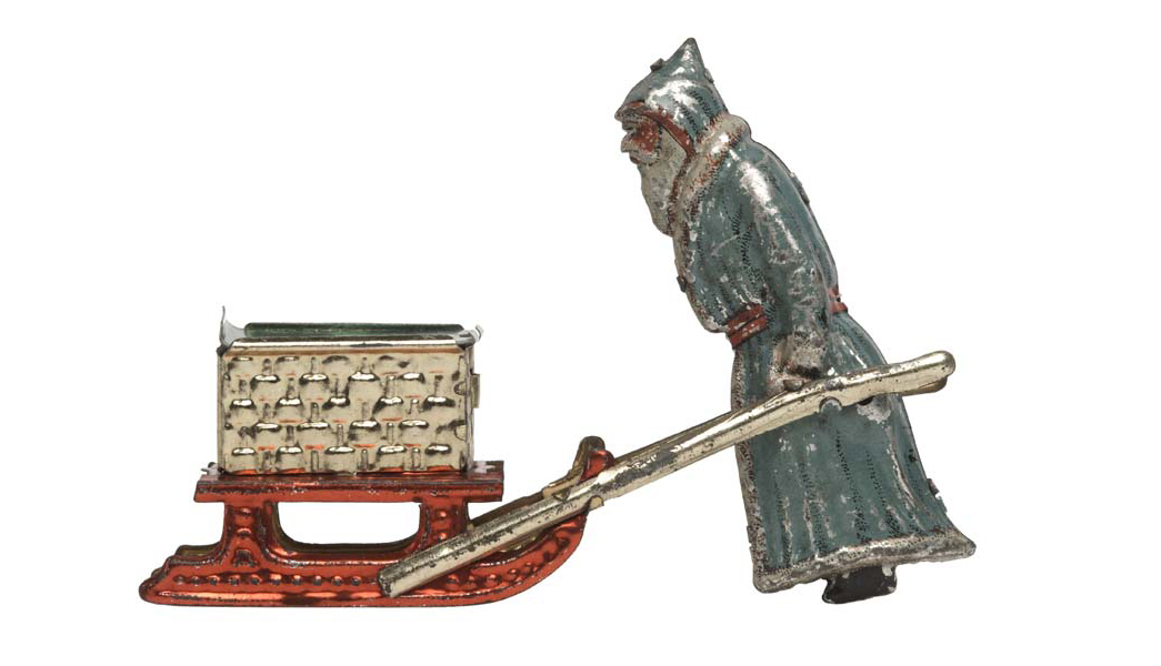 Mechanical lithographed tinplate penny toy Santa Claus and sleigh with candy container. Comprising a lithographed Santa Claus with white beard in grey fur-edged robe.