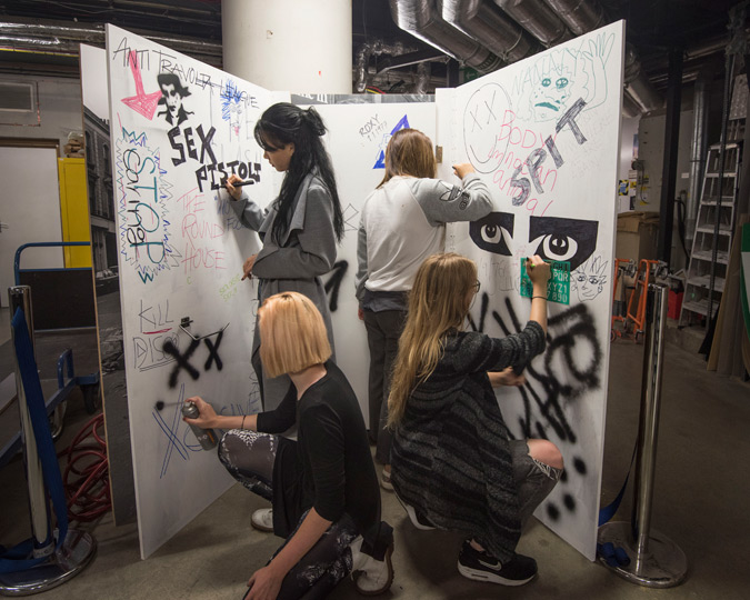 Students from Central Saint Martins decorate a set for the Being Punk Show Space.