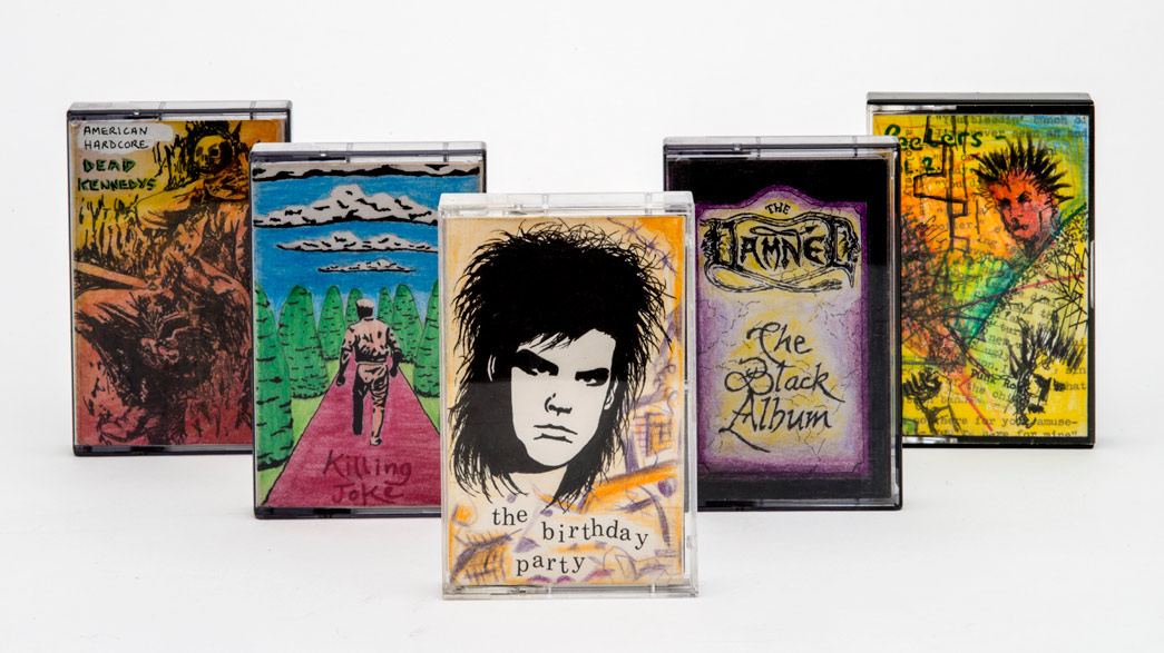 Home-decorated cassette tapes of punk bands, created by Luke Blair.