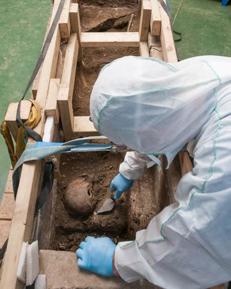 Pre Construct Archaeology excavate human remains from the Southwark sarcophagus
