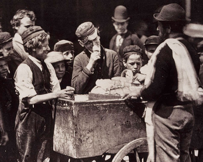 Photograph of children buying ice cream for a halfpenny.