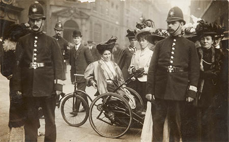 Wheelchair bound Suffragette.