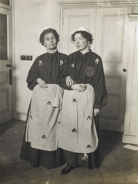 The Suffragette leaders Emmeline and Christabel Pankhurst dressed in replica prison clothing. Replica prison uniforms were often worn by ex-suffragette prisoners at demonstrations and fund-raising bazaars to highlight the conditions under which imprisoned Suffragettes were held.