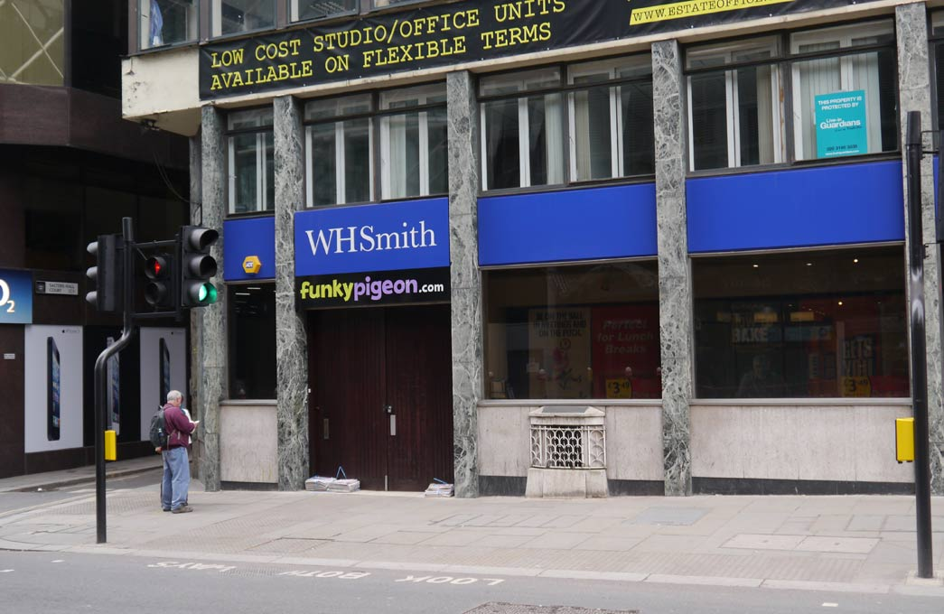 The London Stone in 2012 on Cannon Street, in premises then occupied by WH Smith. Photograph by John O'London.