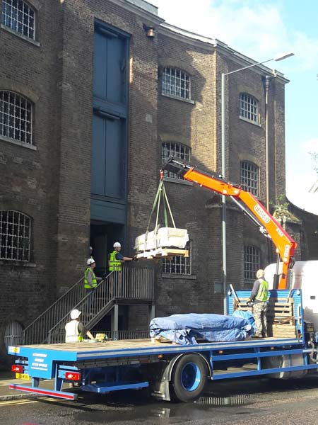 Bringing the sarcophagus into the Museum of London Docklands by crane.