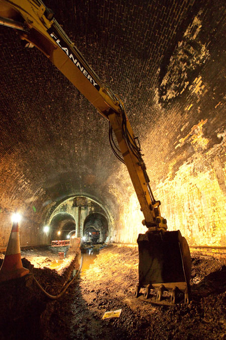 A digger excavating debris from a tunnel as part of the Crossrail project.