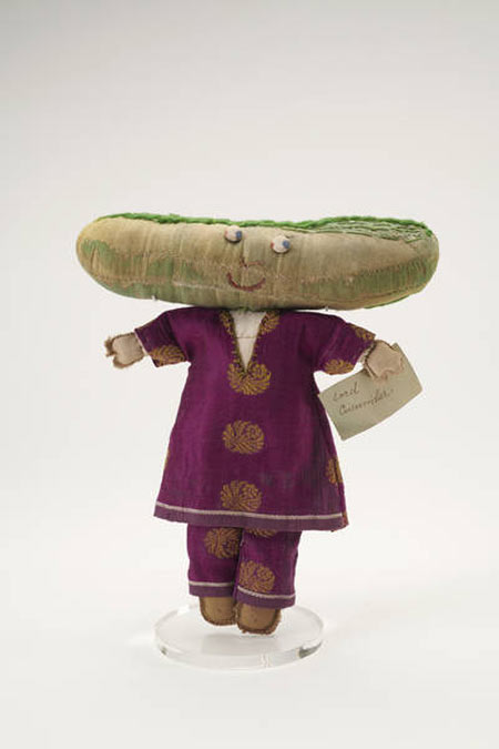 Lord Cucumber vegetable doll on its mount.