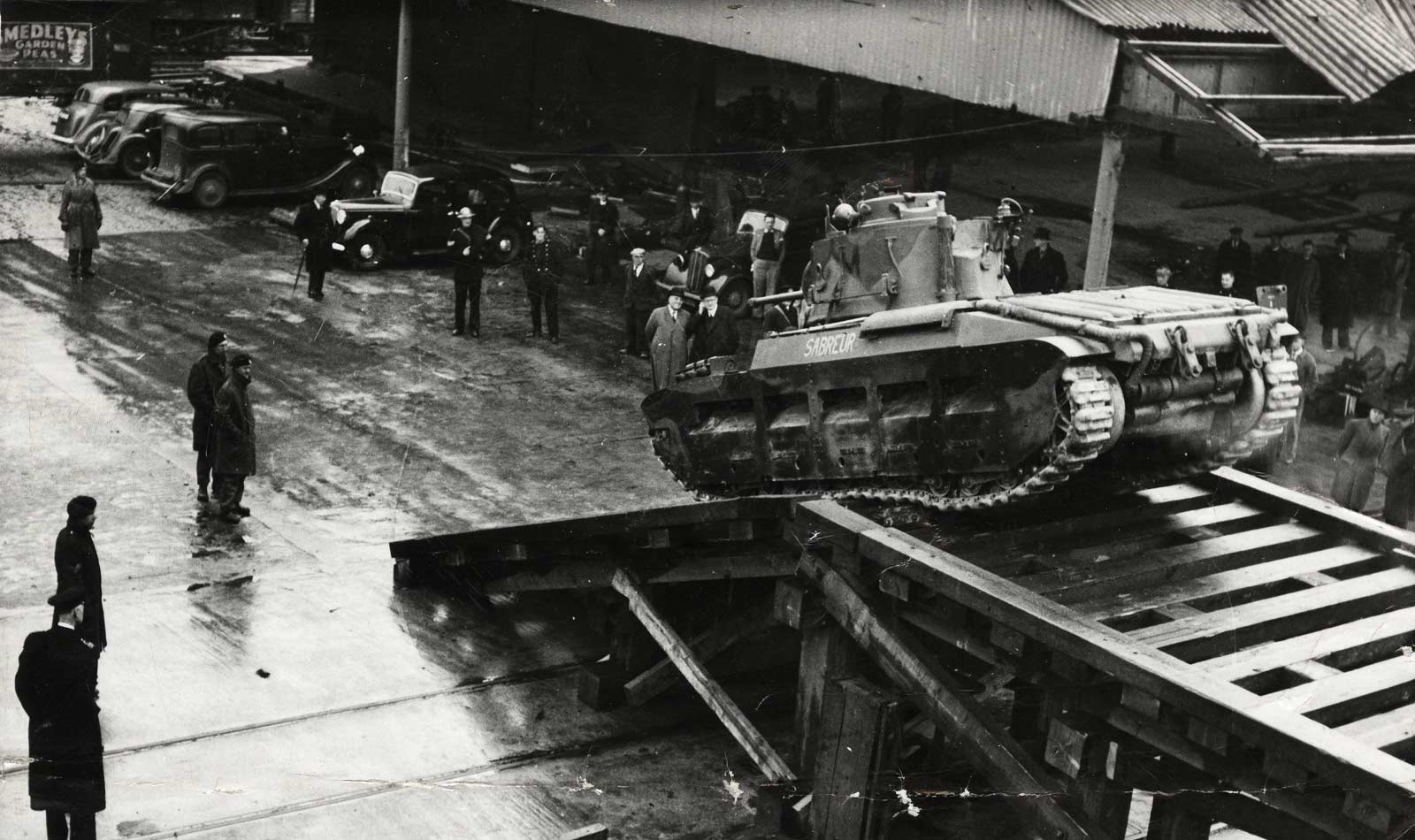 Tanks being embarked onboard ship at the Port of London, ready for the D-Day invasion. Copyright PLA Archive/Museum of London.