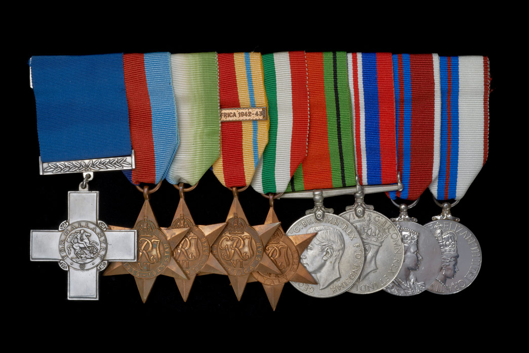 The medals of Richard Moore, including his George Cross at the front of the selection.