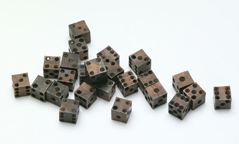 Loaded medieval dice on display in Revealing the past