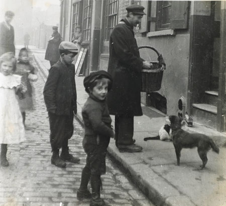 A cats meat man, circa 1900. The cats meat man sold cheap meat as pet food. The meat was unfit for human consumption and often too rotten for pets.