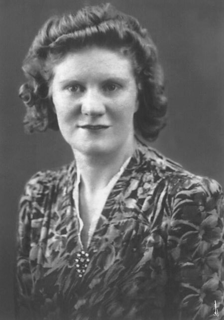 Ivy Hollis (nee Ferguson), born 1916. Ivy grew up on the Isle of Dogs and was a good student, frequently top of her class.