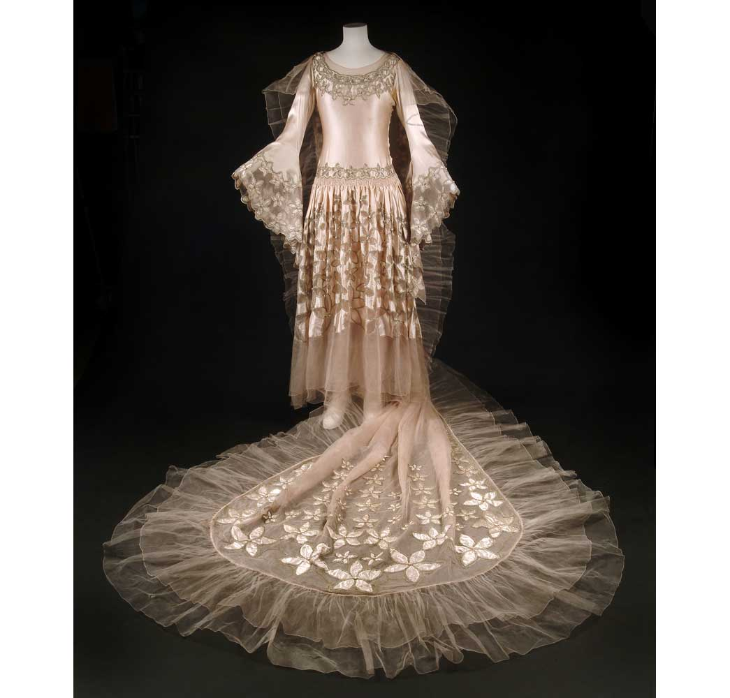 This spectacular dress was worn by Mrs Carl Bendix, later Viscountess Allenby of Megido, at the Dream of Fair Women Ball held at Claridge's Hotel in February 1928. The Ball's theme was 'women of the past, present and future' and this dress represented the present. The dress was given to the London Museum after the ball to be 'exhibited after 1960 as a perfect specimen of our quaint period'.