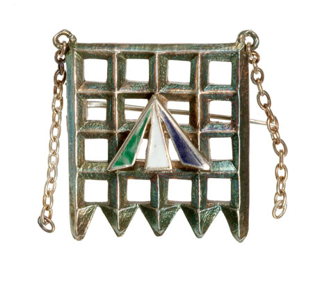 Designed by Sylvia Pankhurst, this silver Holloway brooch incorporates a silver portcullis, representing parliament, with a central, enamel convict's arrow in the suffragette colours of purple, white and green. The brooch was awarded by the Women's Social and Political Union to members who served a period of imprisonment for their militant suffragette activity.