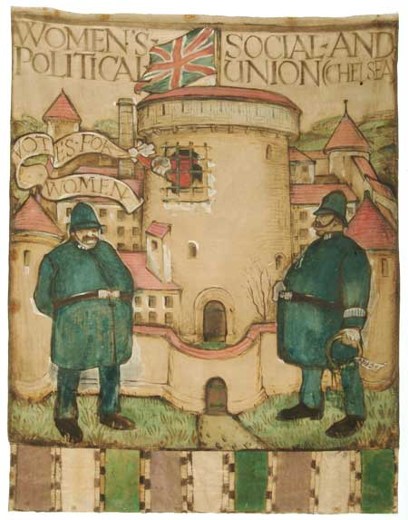 This banner was designed for the Chelsea branch of the Women's Social and Political Union (W.S.P.U) by Herman Ross. It was first unfurled at the Queen's Hall on 17 June 1908 in preparation for Women's Sunday on 21 June. The painted banner depicts two policemen guarding the entrance to Holloway prison, out of which a suffragette prisoner can be seen waving a banner with the slogan 'Votes for Women'. The base of the banner is decorated with the W.S.P.U's colours: purple, white and green. By 1911 the Chelsea branch of the union had opened a shop at 308 King's Road for the sale of suffragette merchandise. The shop's basement became a workshop for the design and production of campaign banners.
