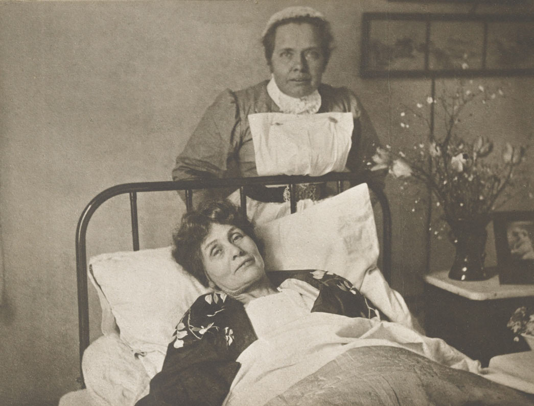 Emmeline Pankhurst with Nurse Pine on her release from prison and hunger strike. On 3rd April 1913 Emmeline Pankhurst was sentenced to three years penal servitude for incitement to place an explosive in a building at Walton, Surrey. In prison she immediately went on hunger strike and was subsequently released after several days. On her recovery she was rearrested and thus began a pattern of hunger strike, release, recuperation and rearrest that continued until the end of July when the police finally decided not to rearrest. During each period of recuperation from hunger strike Emmeline Pankhurst found refuge in a number of safe houses and was always nursed back to health by Catherine Pine.