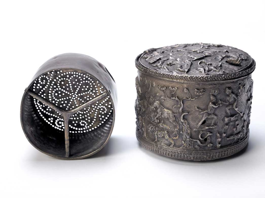Roman silver box and strainer. It may have been associated with an initiation ceremony. This is one of the most mysterious finding from the temple of MIthras. It was found after the removal of a 19th century foundation cut into the north wall of the temple. Its porpose is uncertain and the symbolism of the figures of men and animals on the box is obscure. It may be connected with the idea of death and re-birth associated with an initiation ceremony.