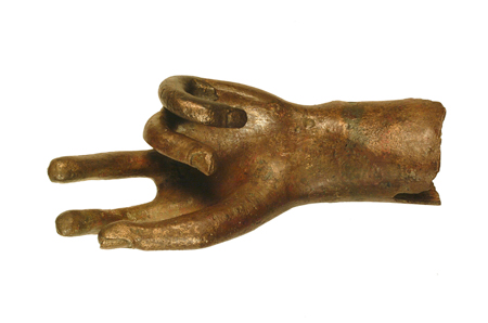 This left handprobably belonged to a statue of heroic size. It shows traces of gilding. It was found at Gracechurch Street, Cornhill, London.