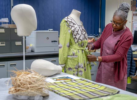 Iyamide Thomas prepares dress for display