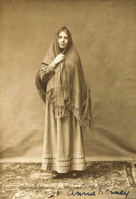 Photograph of suffragette Annie Kenney in the dress of a working woman, signed by Annie Kenney. 1905-1914